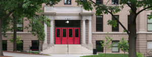 a courthouse with double doors painted red